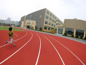 Pupil running on the new sports ground of Britannica International School Shanghai