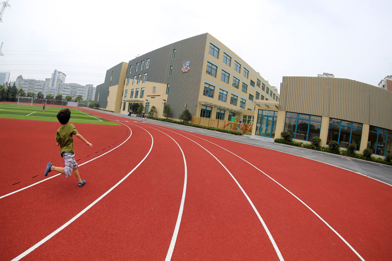Pupil running on the new sports ground of Britannica International School Shanghai