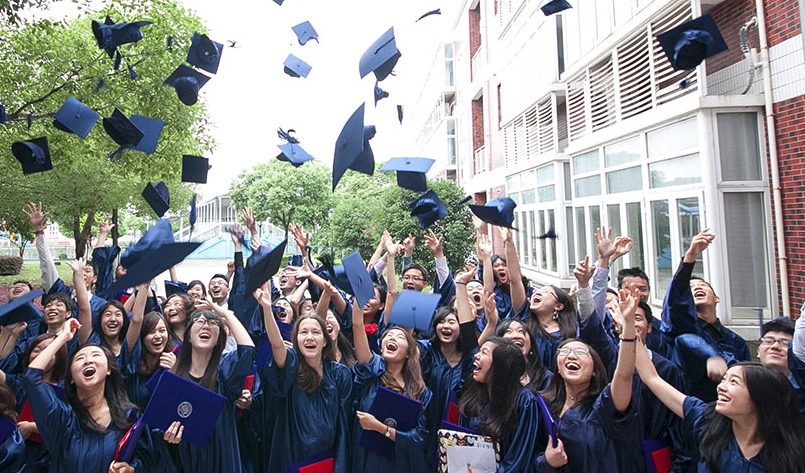 Students throw away their hats at SMIC private school of Shanghai