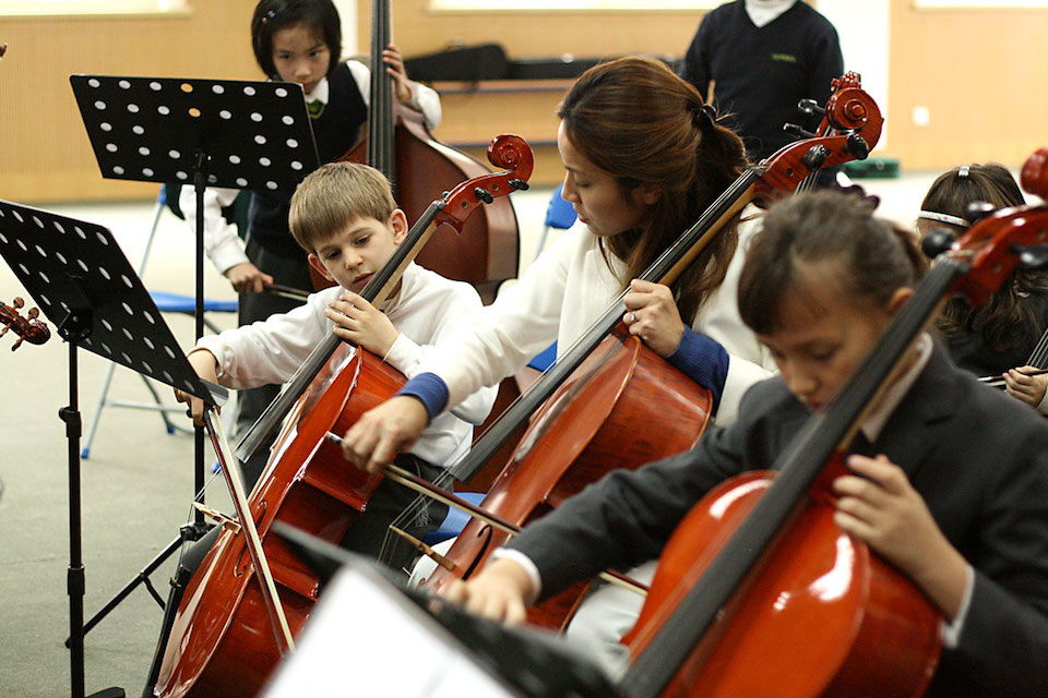 children with classical instruments at YK Pao School in Shanghai